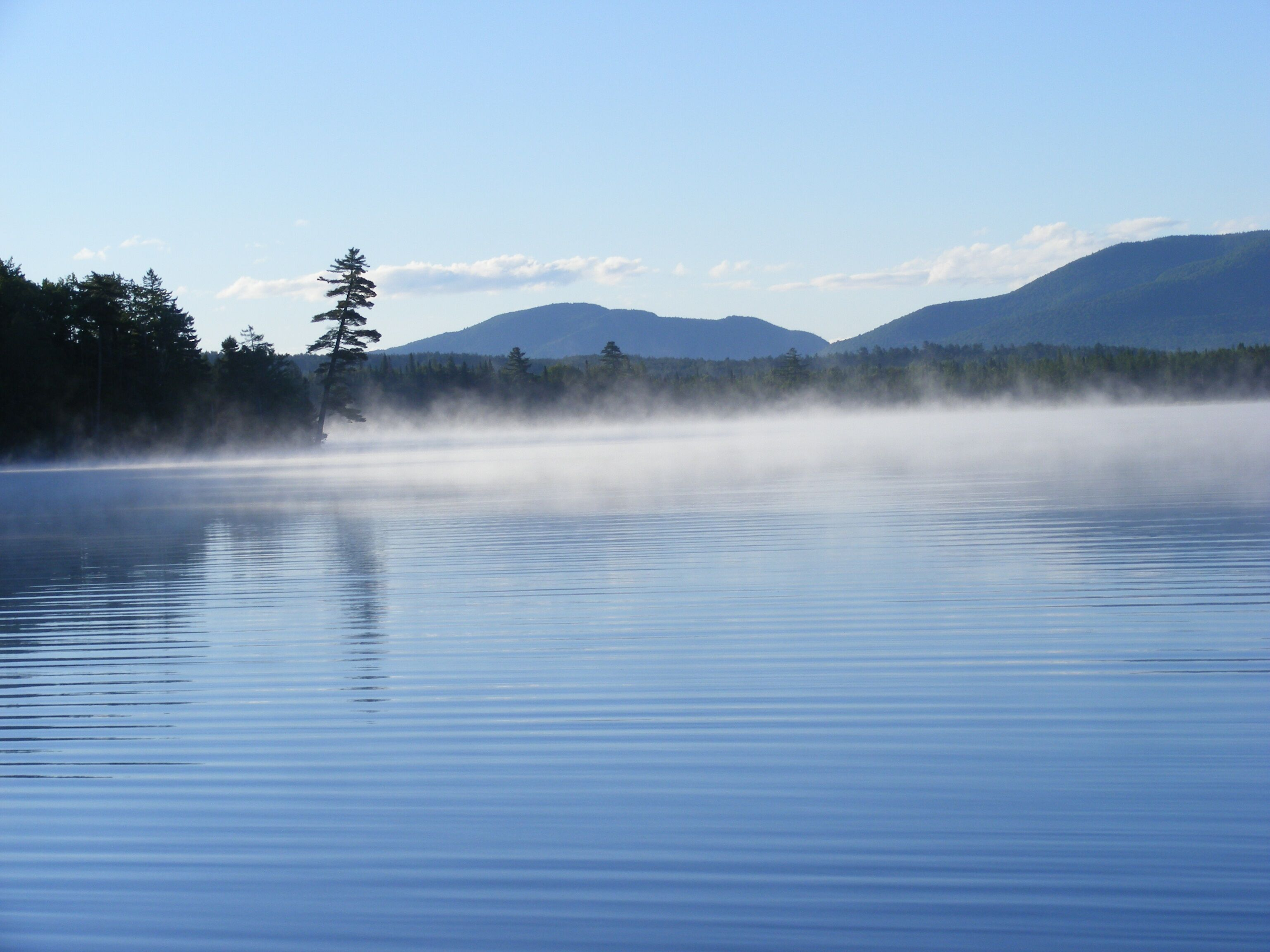 morning fog on the lake at deer river campsite in malone ny